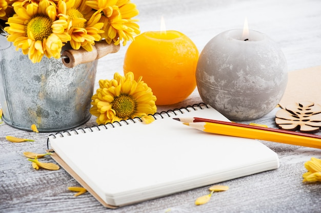 Empty notebook and chrysanthemum