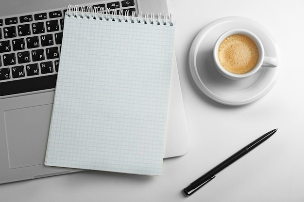 Empty  notebook on laptop keyboard, on light