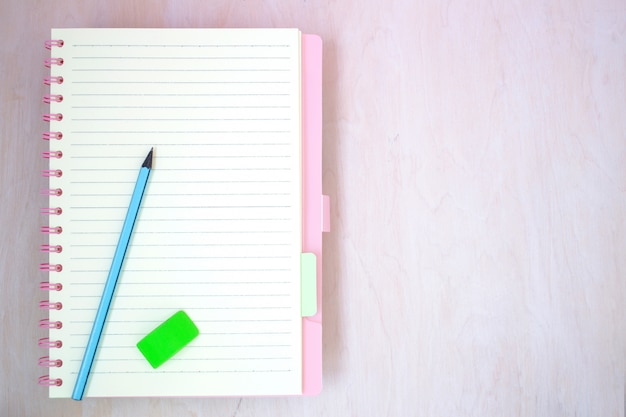 Empty notebook paper for text with blue pencil