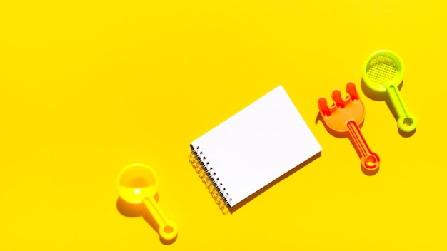 Empty notebook with scoops and rake