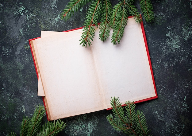 Empty notebook with tree branches. top view