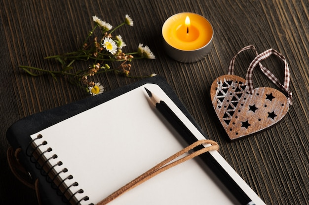 Empty notebook with wild flowers