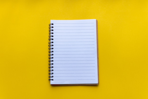 Empty notebook on yellow