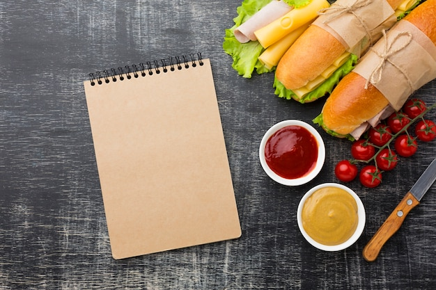 Empty notepad and sandwiches