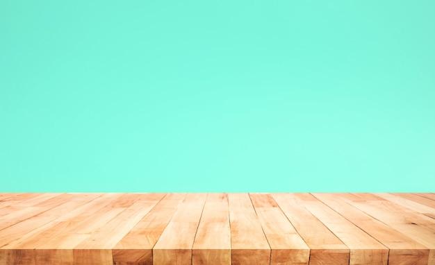 녹색 파스텔 색상 배경에 나무 테이블 상단의 빈