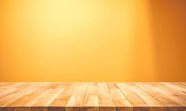 黄色のパステルカラーの背景に木製のテーブルトップの空