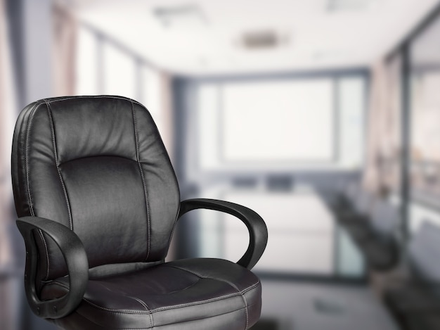 Empty office chair with office background
