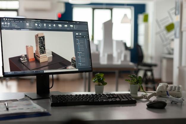 책상 위에 컴퓨터가 있는 건축가를 위한 빈 사무실