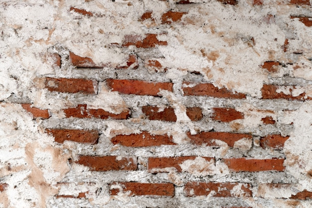 Empty old brick wall texture. painted distressed wall surface. grungy wide brick wall.