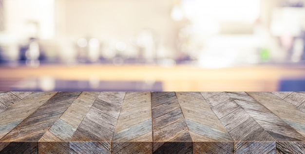 Empty old plank wooden table top with blurred home kitchen