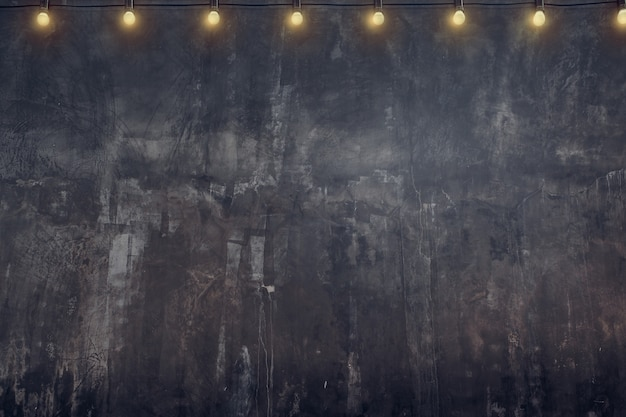Empty old rustic grunge concrete wall with light bulb string party background