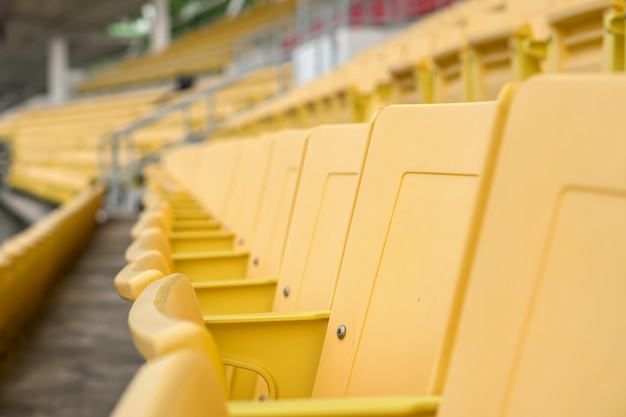 Empty old seat got abandoned in stadium with no spectators