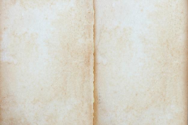 空の古いビンテージ茶色のページ紙テクスチャ背景。