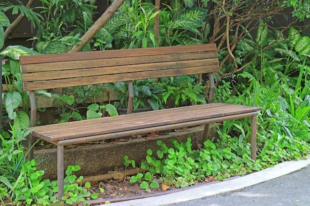 Empty old wooden bench in the garden