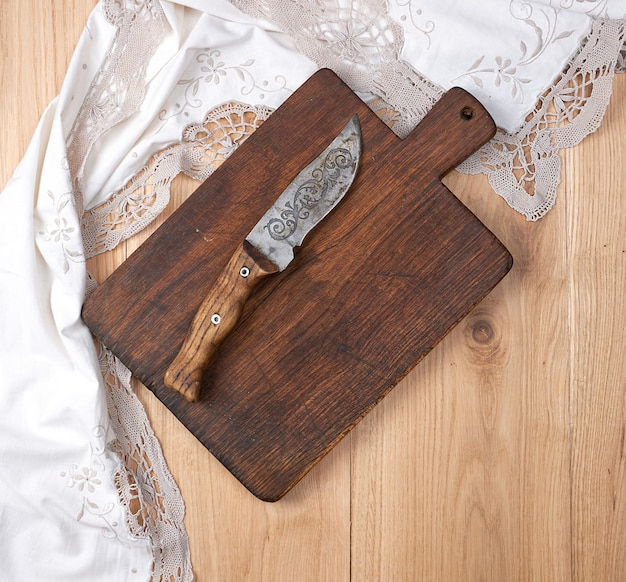 Empty old wooden kitchen cutting board and knife