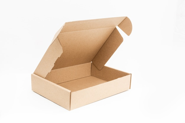 Empty open cardboard box on surface with empty space