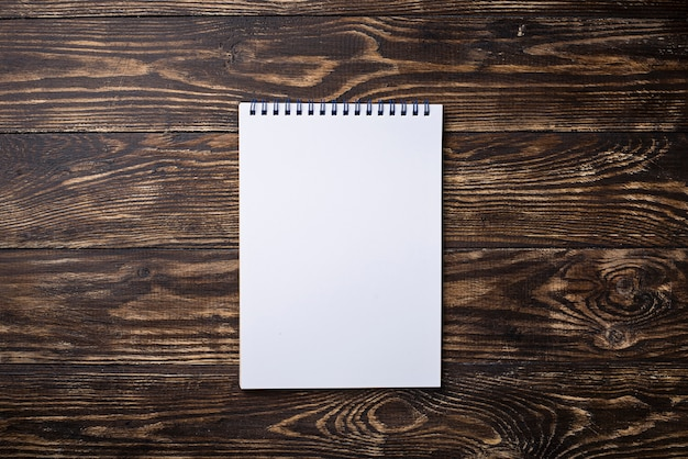 Empty open notebook on wooden surface