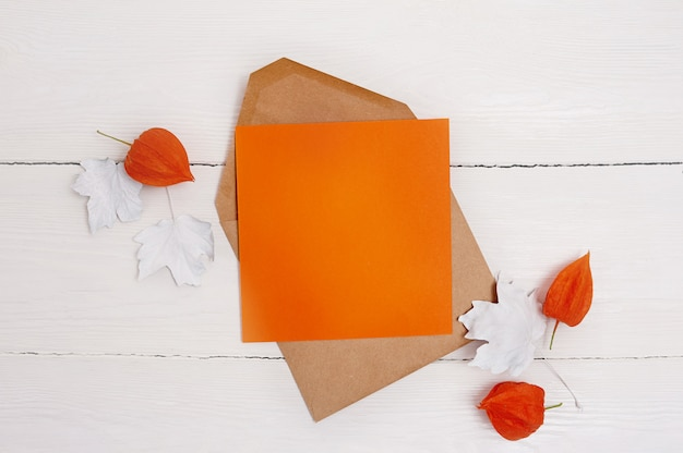 Empty orange sheet of paper flat lay mockup for your art, picture or hand lettering composition