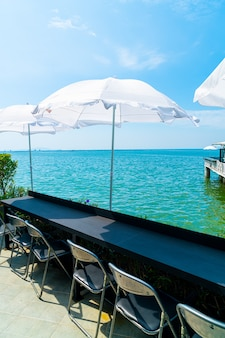 Empty outdoor bar and chair with sea