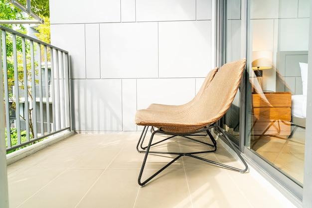 Empty outdoor patio chair on balcony
