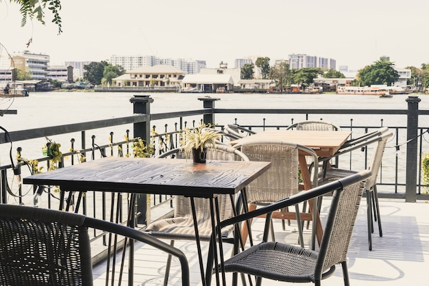 Empty outdoor patio table and chair in restaurant