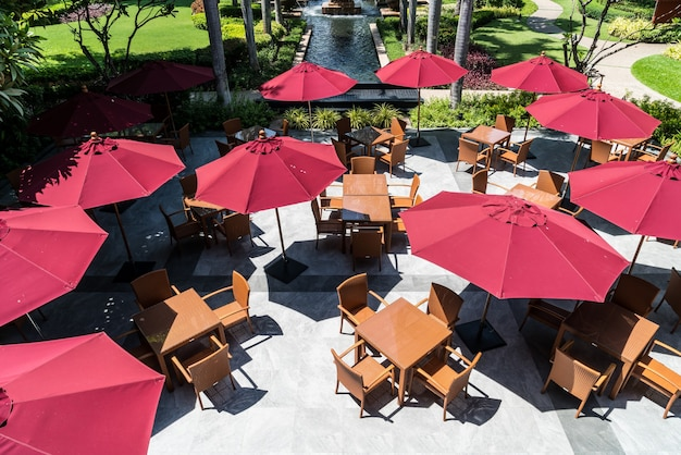 Empty outdoor patio table and chair with umbrella