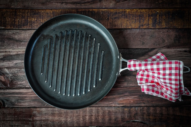Empty pan grill on a wooden surface
