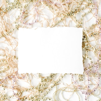 Empty paper blank and christmas tinsel decoration.