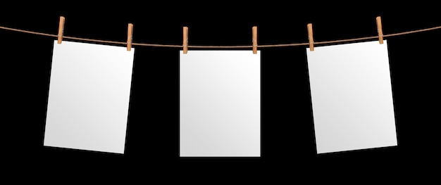 Empty paper sheet hanging on rope, isolated on black background, mock up for your project, poster template