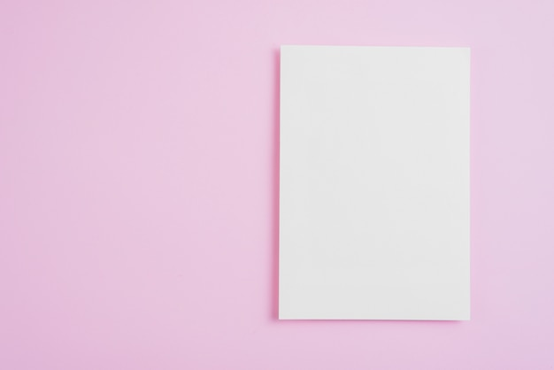 Empty paper sheet on pink