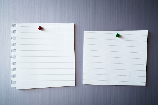 Empty paper sheet on refrigerator door. paper note with magnet.