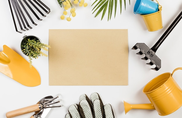Empty paper surrounded by gardening tools