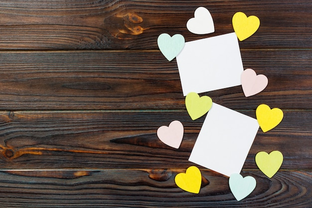 Empty paper over wooden background with colorful heart on valentines day copyspace