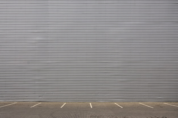 Empty parking spaces on the background of a metal wall