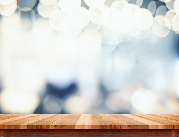 Empty perspective wood plank table top with abstract bokeh light background