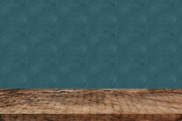 Empty perspective wood plank table top with green background for montage of your product
