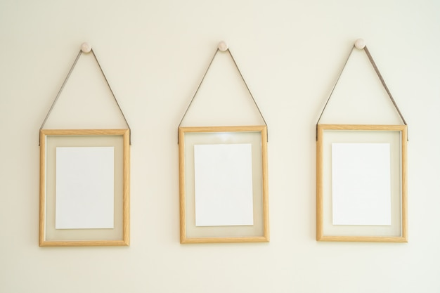 Empty photo frames on wall