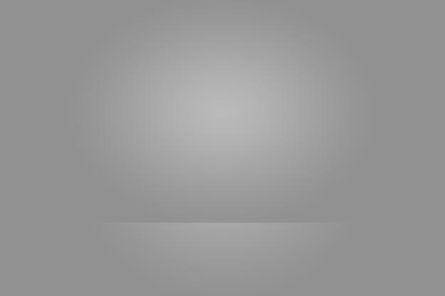 Fondo vuoto dello studio del fotografo estratto, struttura del fondo di bellezza blu chiaro scuro e chiaro, grigio freddo, parete piana e pavimento di pendenza bianca nevosa.