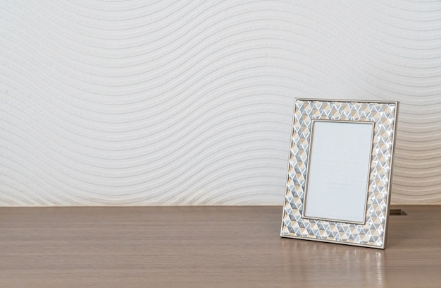 Empty picture frame decoration on white wall with copy space
