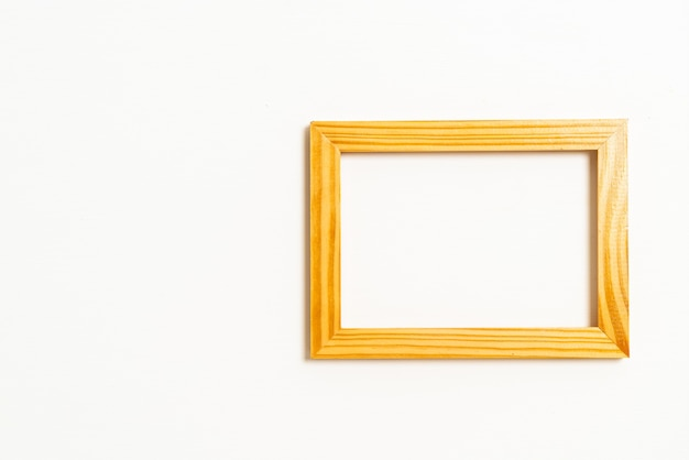Empty picture frame on white wall with copy space