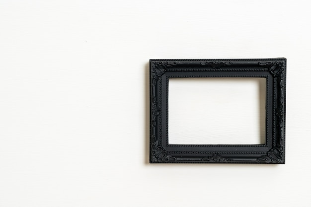 Empty picture frame on white wall