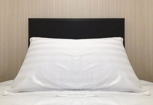An empty pillow on single bed which preparing for guest.