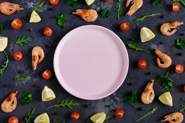 An empty pink plate lies in the center of a dark textured background.