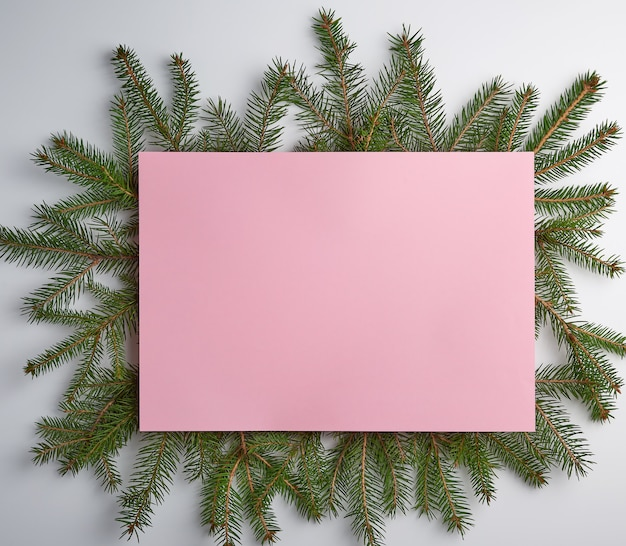 Empty pink sheet and green branches