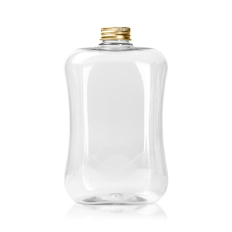 Empty plastic bottle with gold cap isolated. clear jar or mason package.