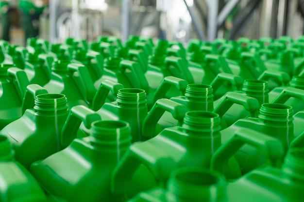 Empty plastic cans green colour for liquids.