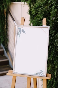 Empty plastic easel in wooden stand