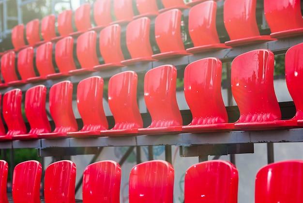 Empty plastic red seats