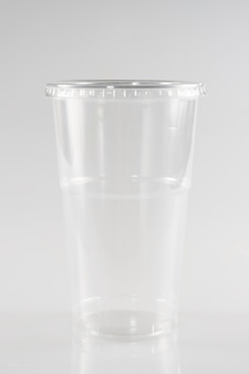 Empty plastic takeaway cup on white background