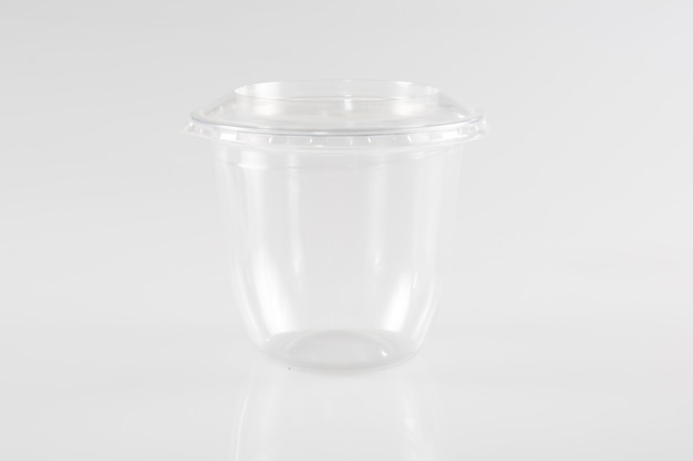 Empty plastic takeaway cup on white